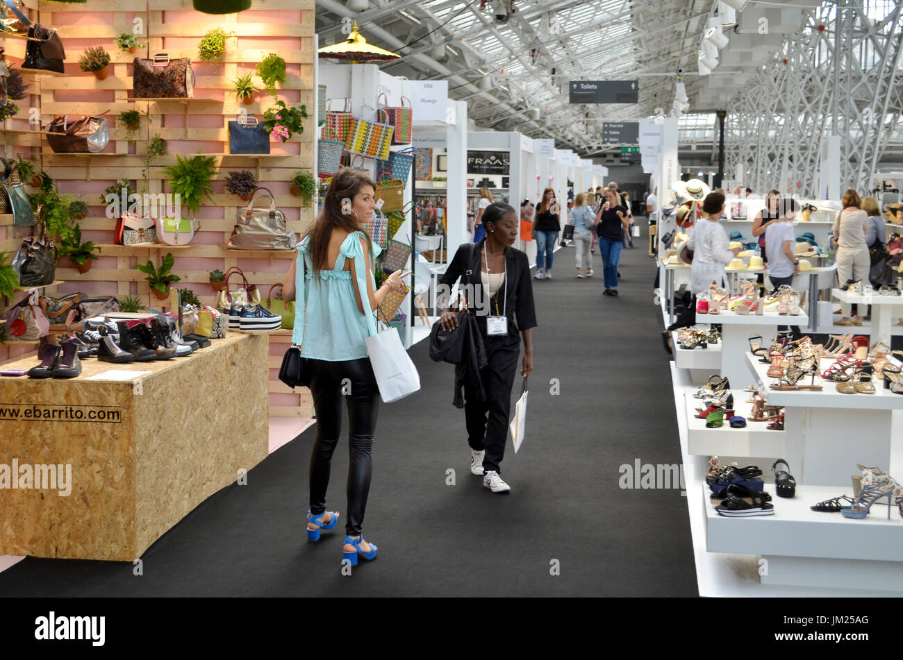Trade Stands Olympia : Fashion buyers browse the footwear stands at pure london olympia