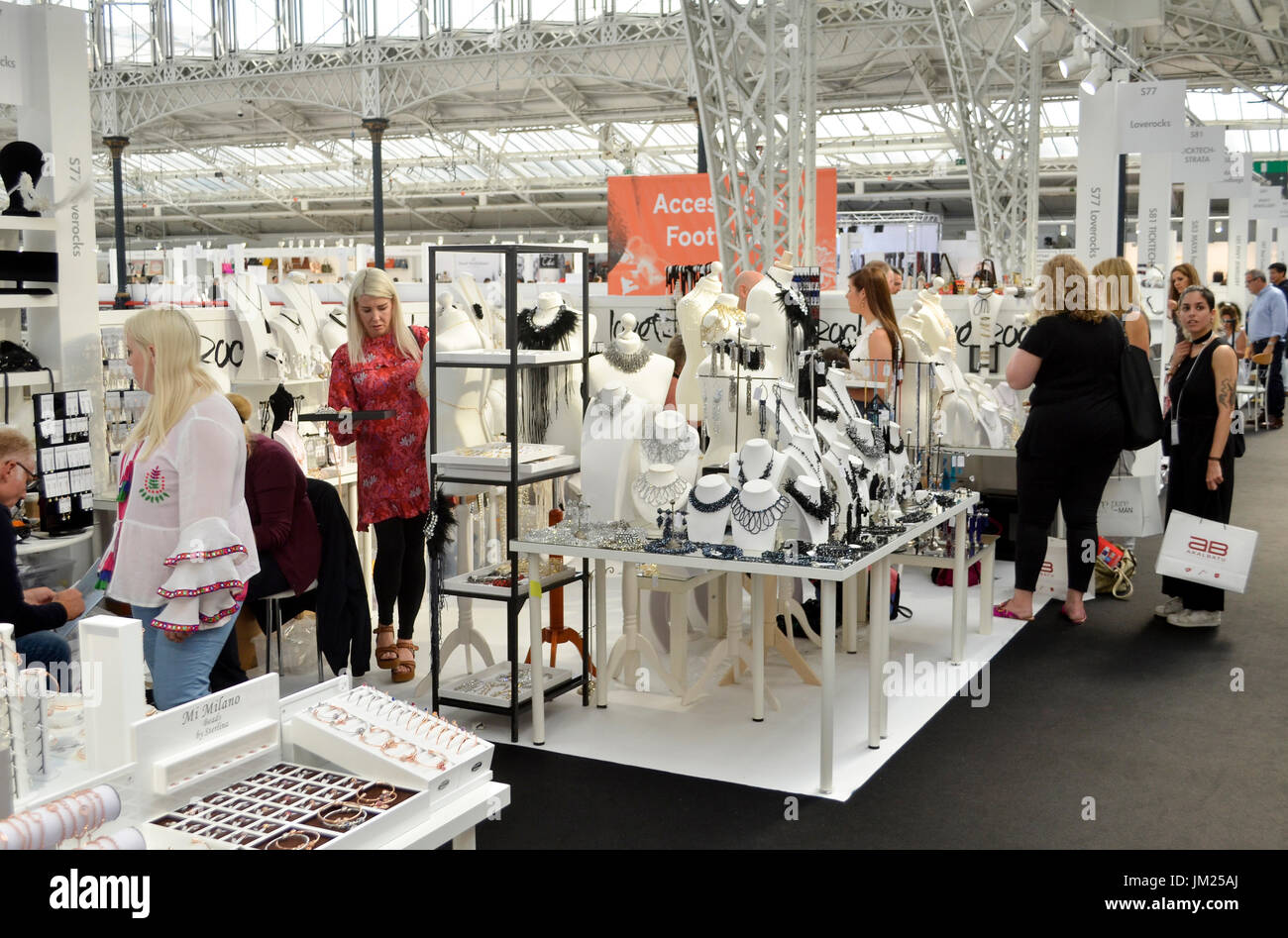 Trade Stands Olympia : Fashion buyers browse jewellery stands at pure london olympia stock