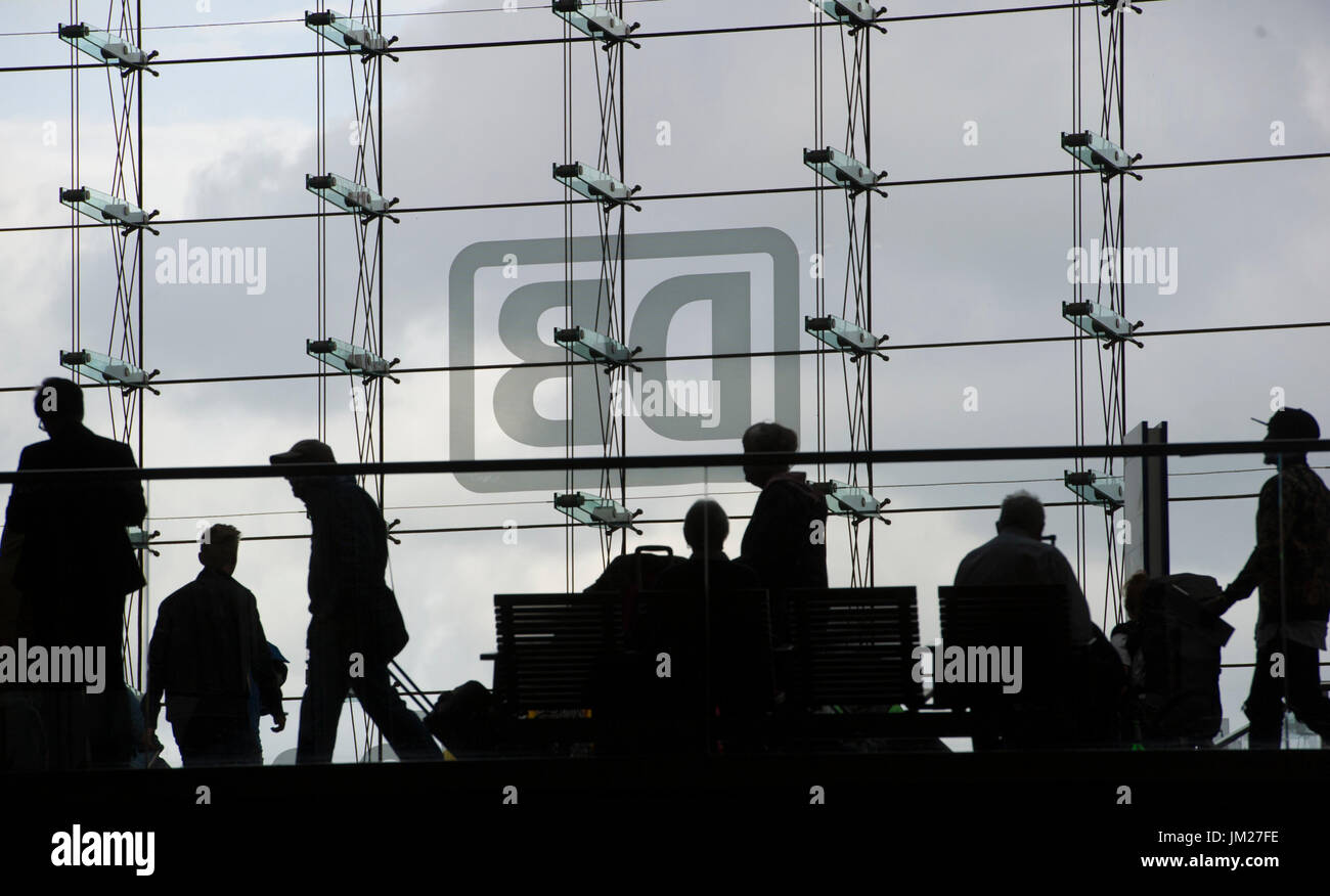 FILE - A file picture dated 30 September 2016 shows the Deutsche Bahn (DB) logo on a glass wall at the main station in Berlin, Germany. Photo: Paul Zinken/dpa - Stock Image