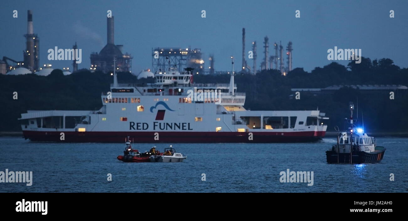 Southampton, UK. 25th July, 2017. Coastguard Helicopter Rescue - A Coastguard helicopter was scrambled to assist in the rescue of a person believed to have suffered a stroke reported struggling in the sea near Netley in Southampton Water at dusk. The peron was transferred from the Calshot lifeboat to helicopter and taken to Southampton General Hospital.Photo:Steve Foulkes/Ajax/Alamy Live News. - Stock Image