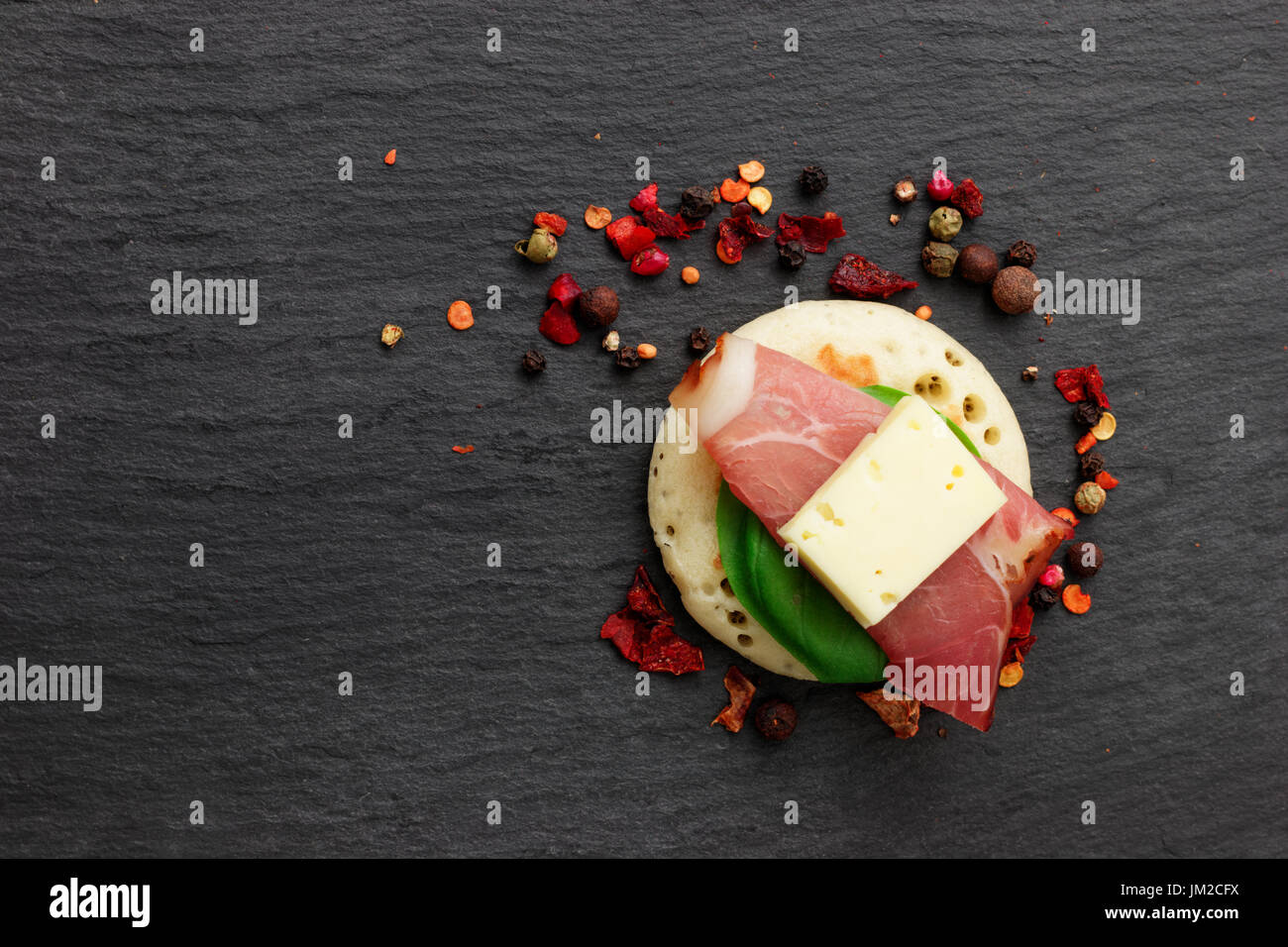 Homemade pancake canapes on slate stone plate for finger food party Stock Photo