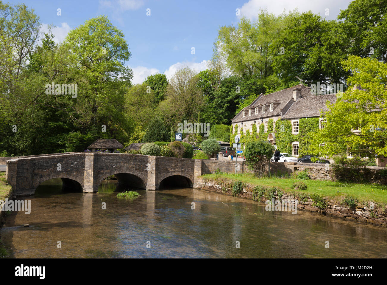 River Coln and The Swan Hotel, Bibury, Cotswolds, Gloucestershire, England, United Kingdom, Europe - Stock Image