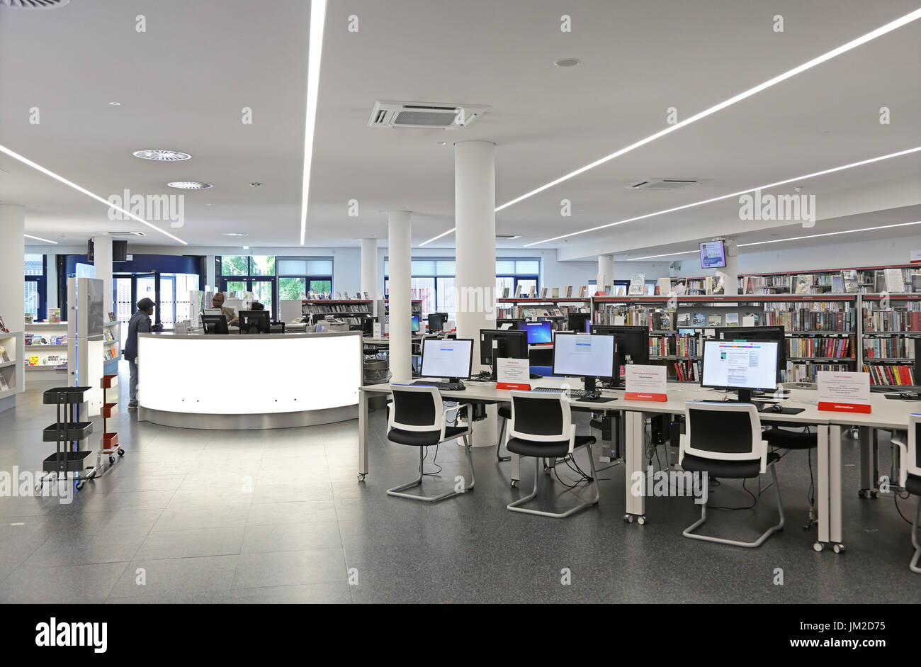 Interior view of the newly rebuilt Marcus Garvey Library in London Borough of Haringey, UK. Shows traditional bookshelves and new computer terminals. - Stock Image