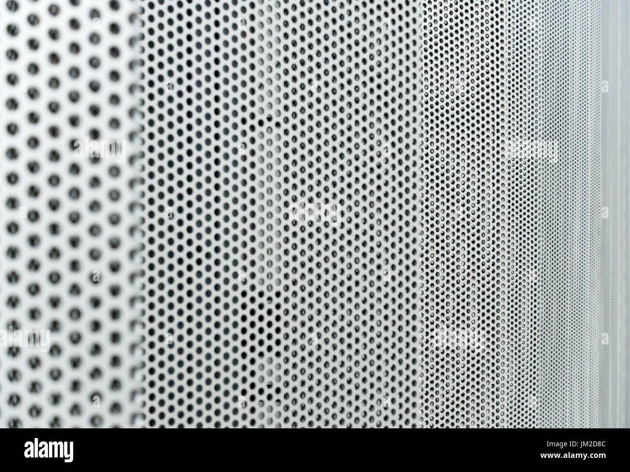 Gray metal background, round perforated metal texture - Stock Image