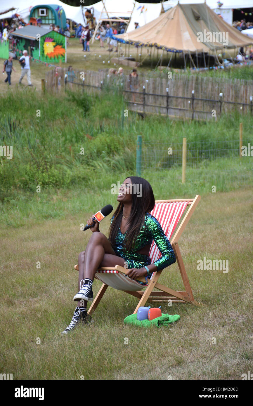 Latitude Festival 2017, Henham Park, Suffolk, UK. TV presenter AJ Odudu doing a piece to camera for E4 - Stock Image