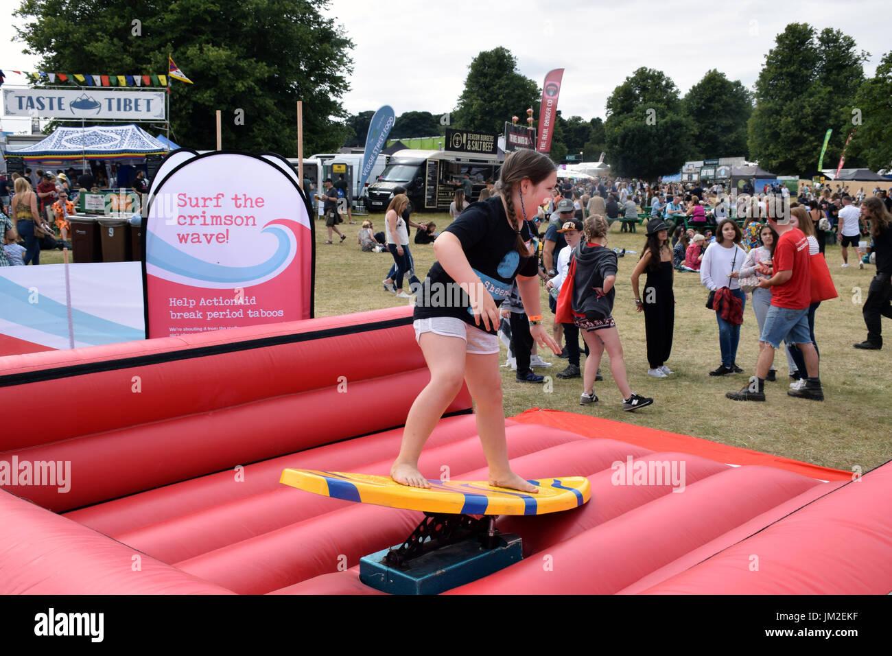 Latitude Festival 2017, Henham Park, Suffolk, UK. ActionAid surf simulator. ActionAid works with the poorest women & girls internationally changing th - Stock Image