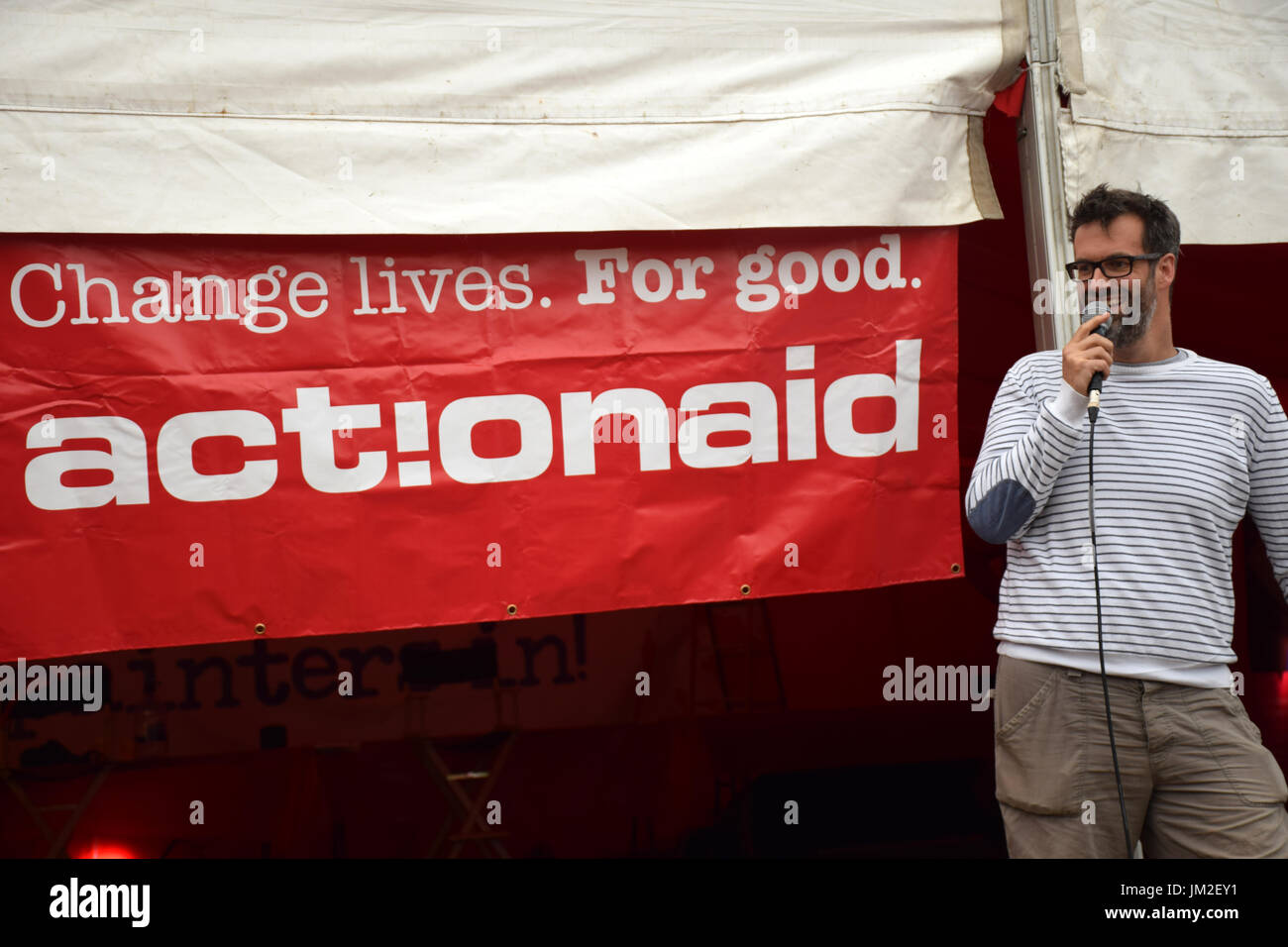 Latitude Festival 2017, Henham Park, Suffolk, UK. Marcus Brigstocke comedian performing at the ActionAid tent.  ActionAid works with the poorest women - Stock Image