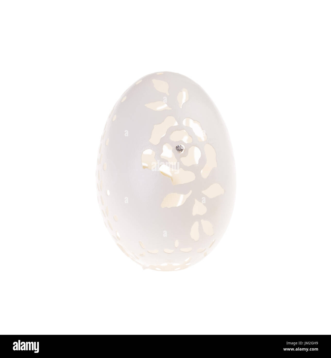 Easter hen's egg with carving. Macro. Isolated on a white background. Stock Photo