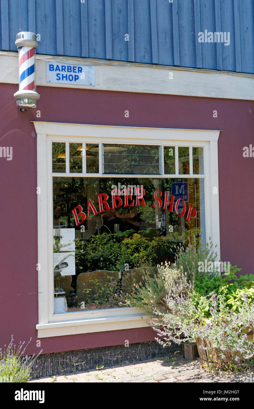 Old-fashioned barber shop in Snug Cove on Bowen Island near Vancouver, British Columbia, Canada - Stock Image