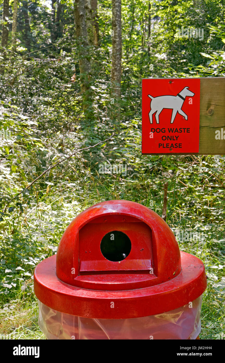 Dog waste receptacle and sign on a hiking trail on Bowen Island near Vancouver, British Columbia, Canada - Stock Image