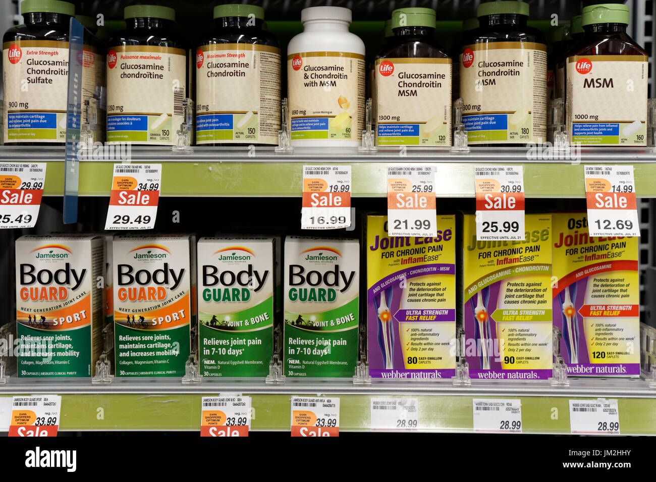 Joint pain remedies and supplements on a drugstore shelf, Vancouver, British Columbia, Canada - Stock Image