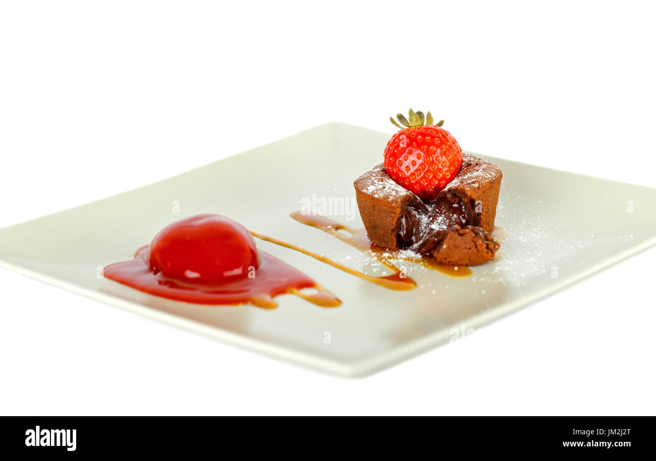 Picture of strawberry lava cake on a white plate - isolated background - Stock Image