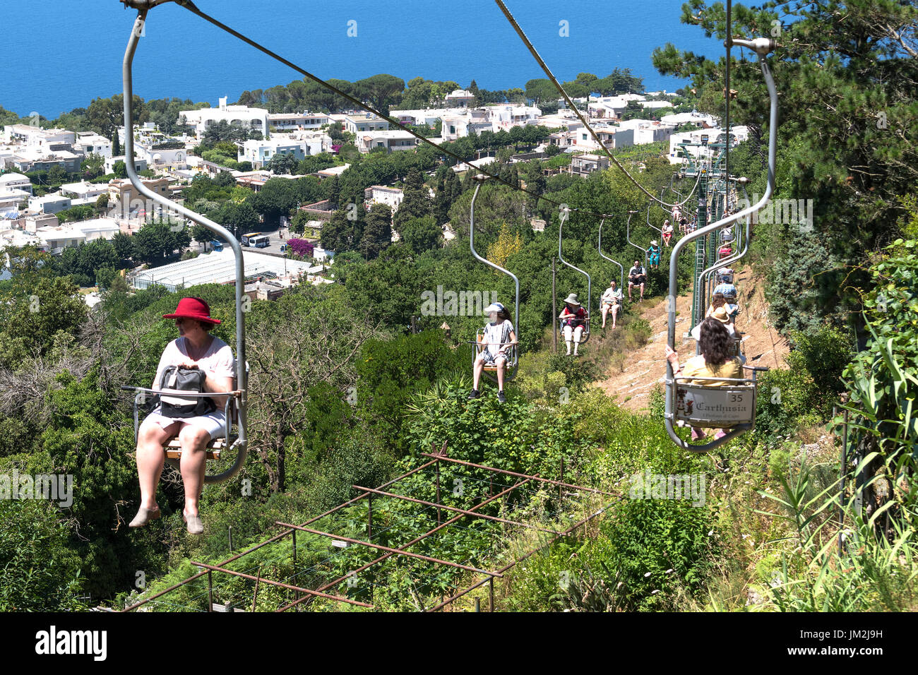 visitors taking the chairlift to the summit of monte solaro on the island of capri, italy - Stock Image