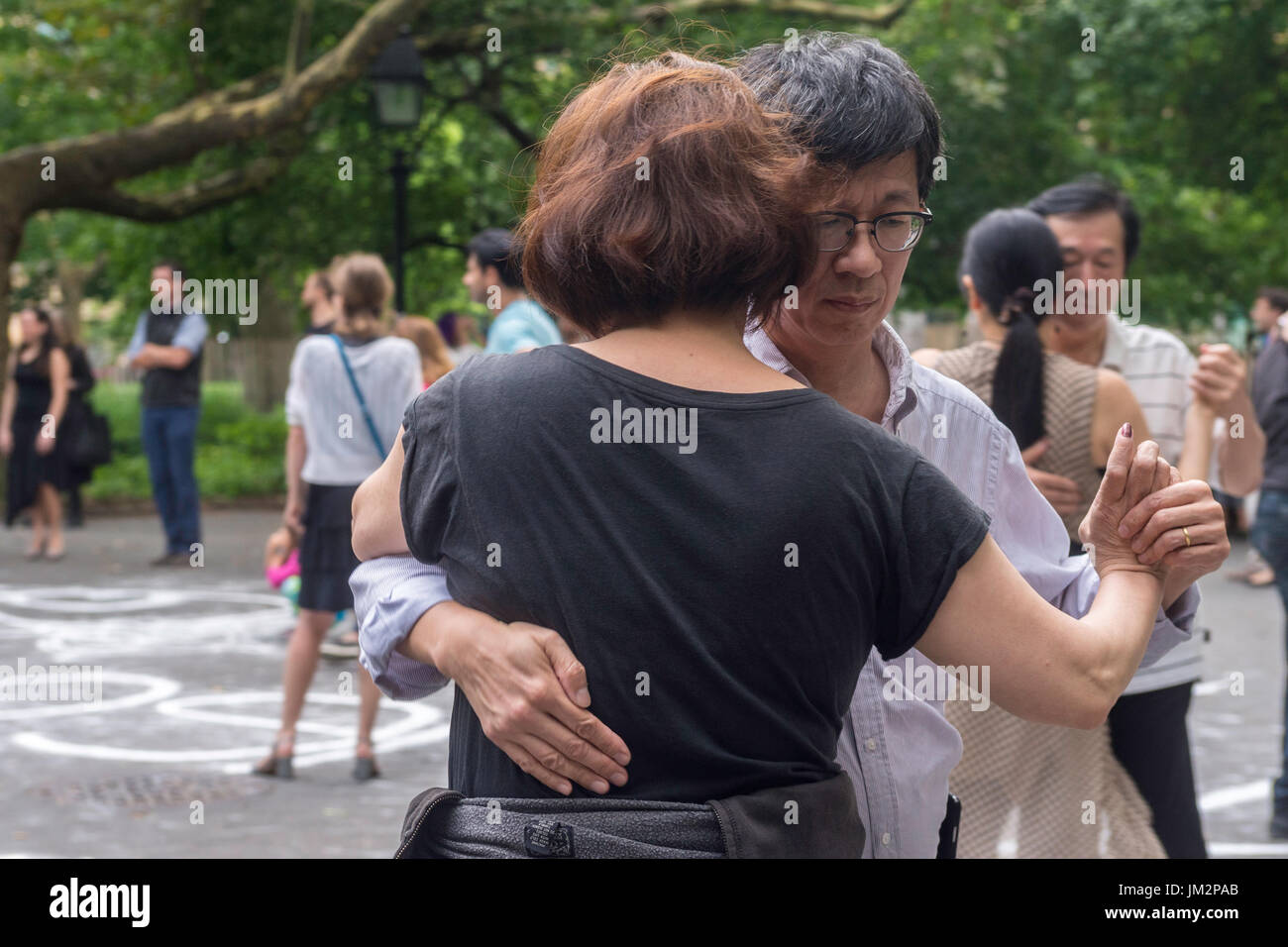 New York, NY 25 July 2017 - Ac ouple dancing the tango on a summer evening in Washington Square Park ©Stacy Walsh Rosenstock - Stock Image