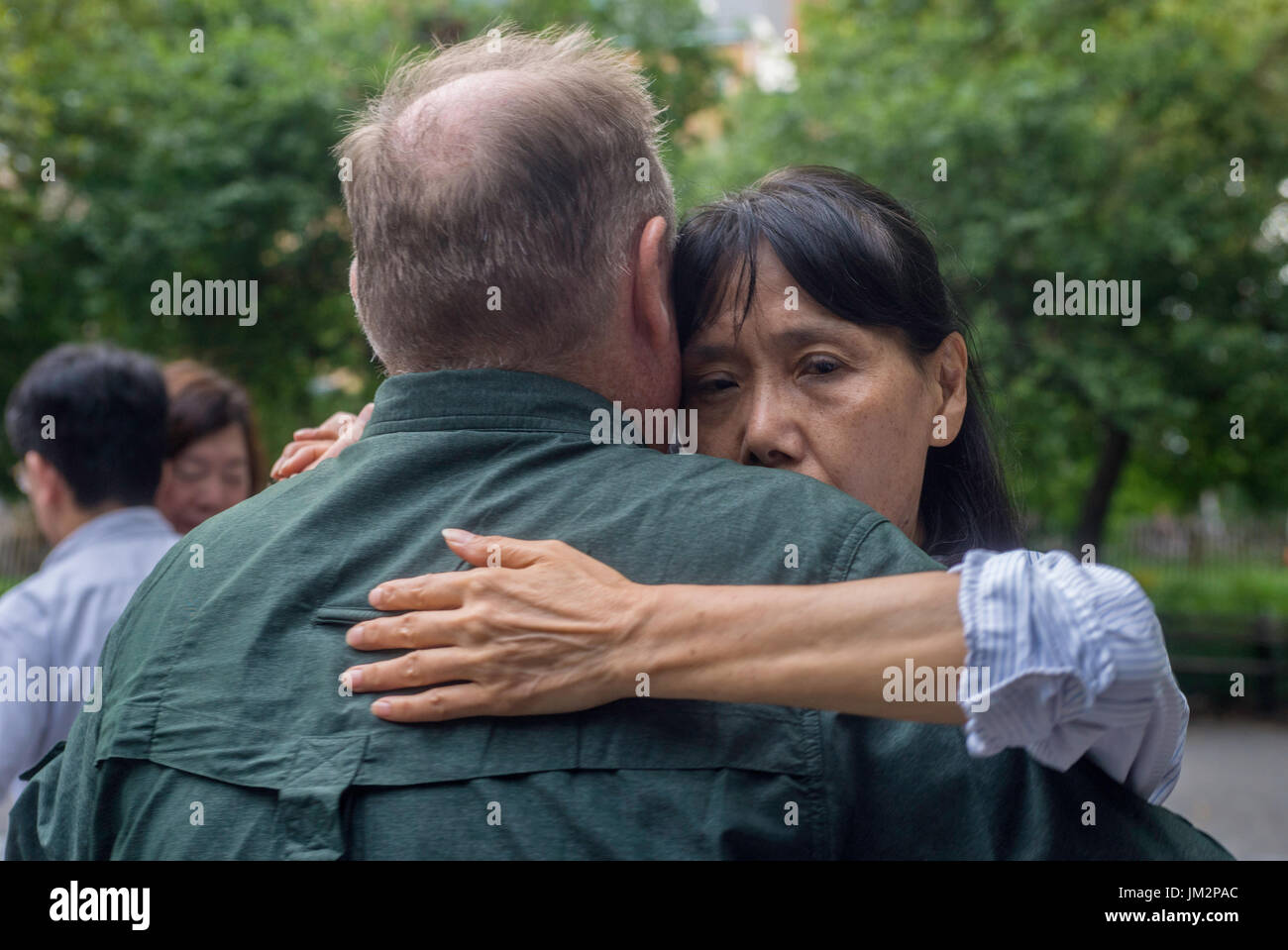 New York, NY 25 July 2017 - A couple dancing the tango on a summer evening in Washington Square Park ©Stacy Walsh Rosenstock - Stock Image