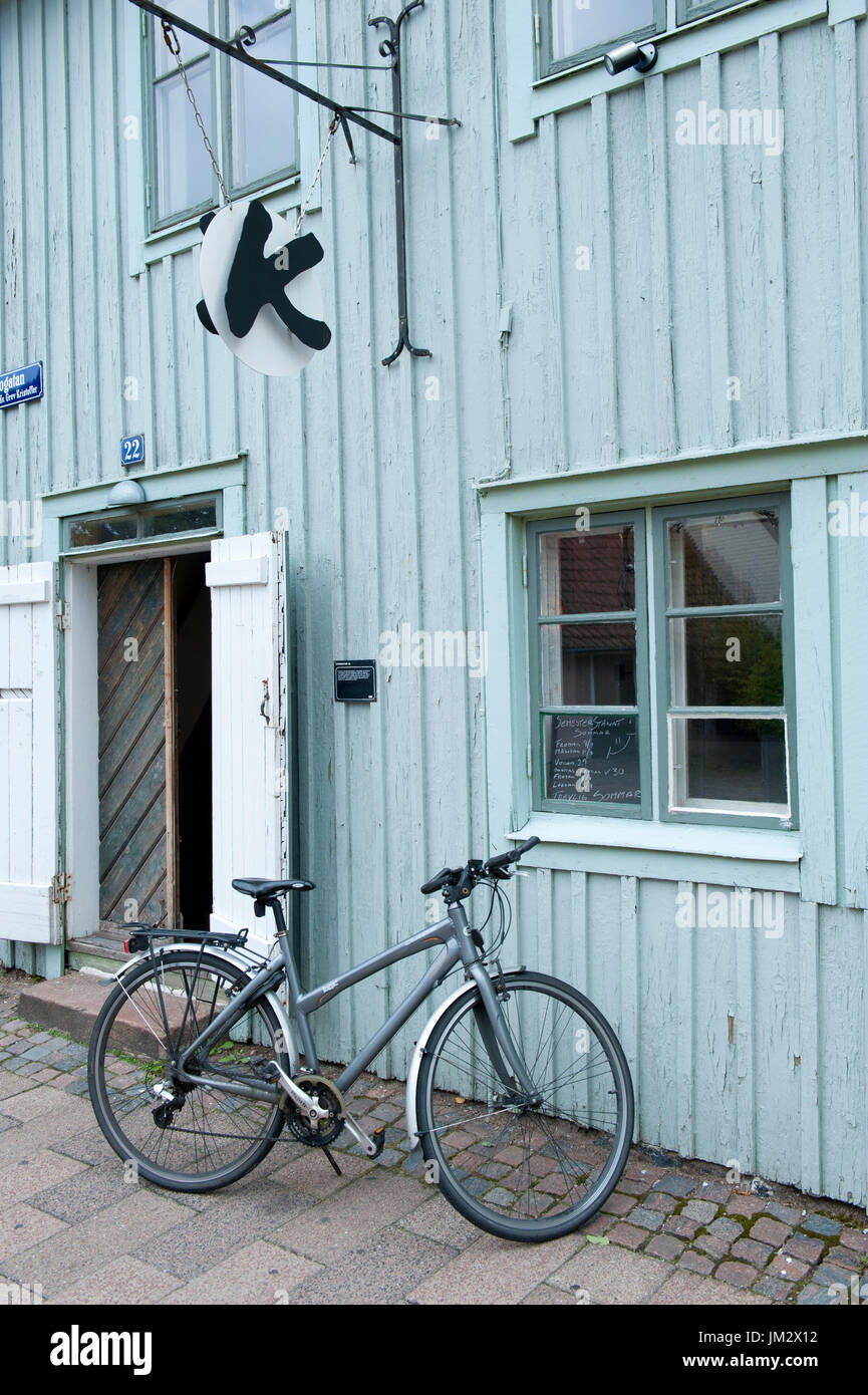 Bicycle parked outside a cafe in Halmstad, Sweden - Stock Image