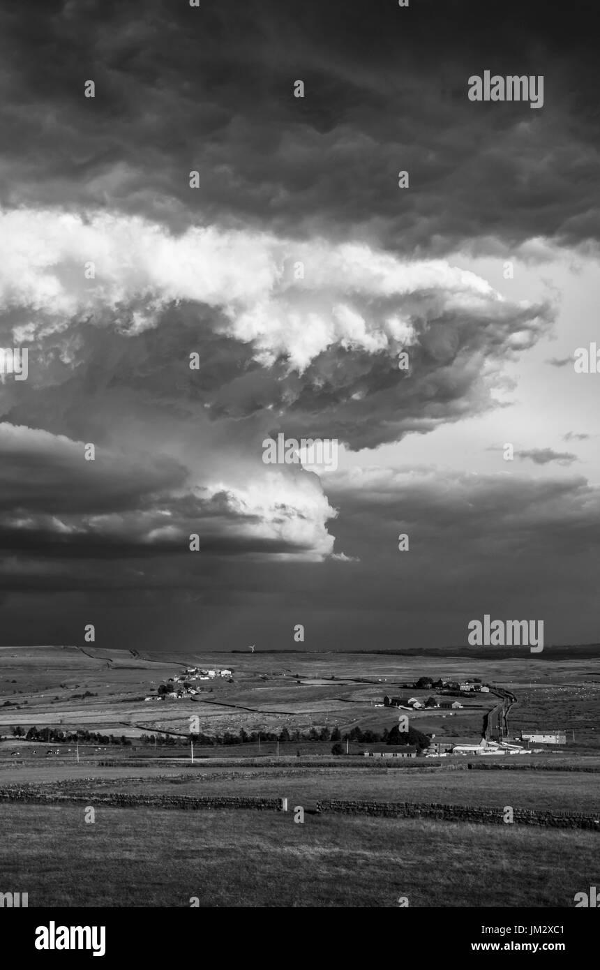 Moody dramatic skies over the yorkshire moors near haworth stock image