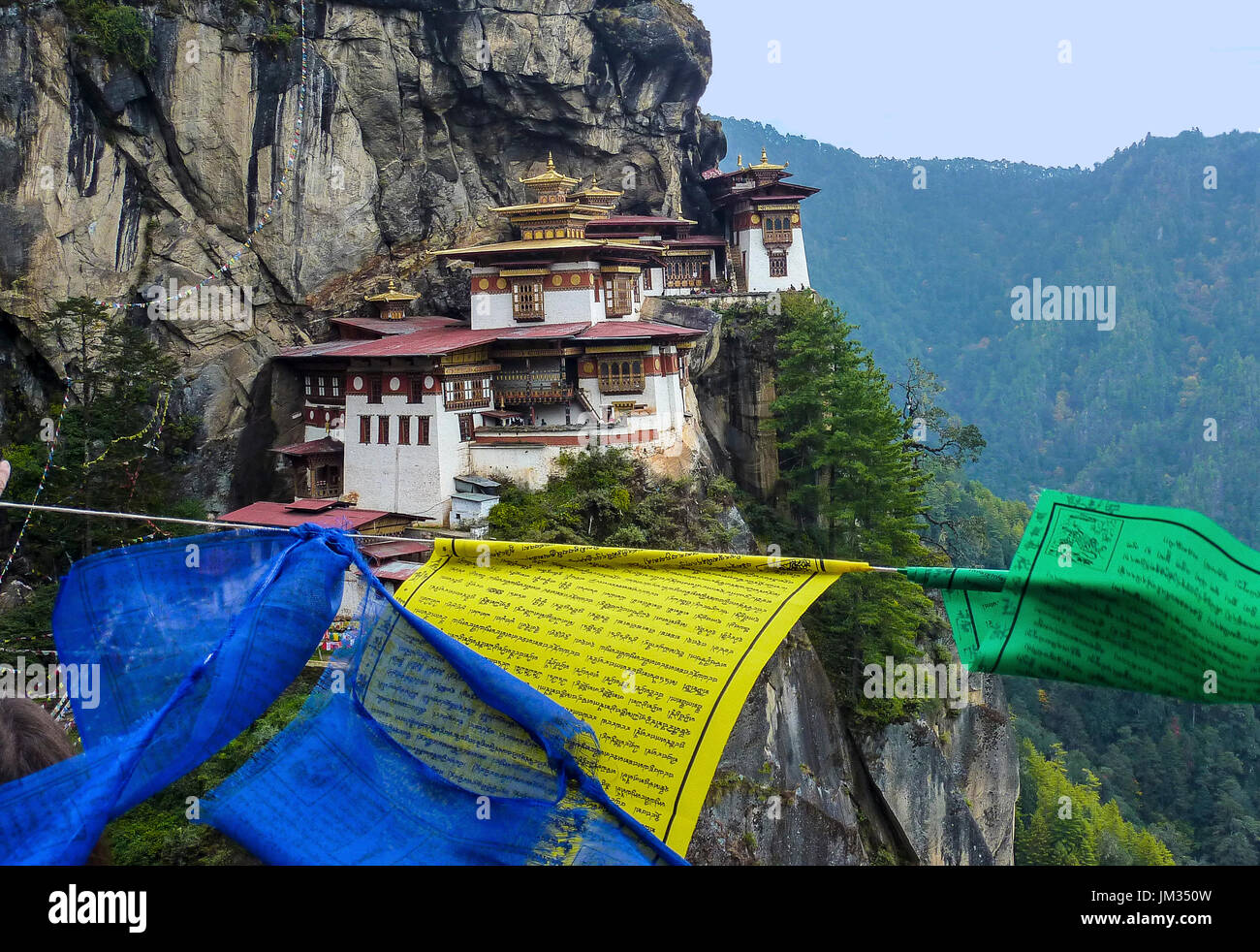 Paro Taktsang with prayer flags - Bhutan - Stock Image