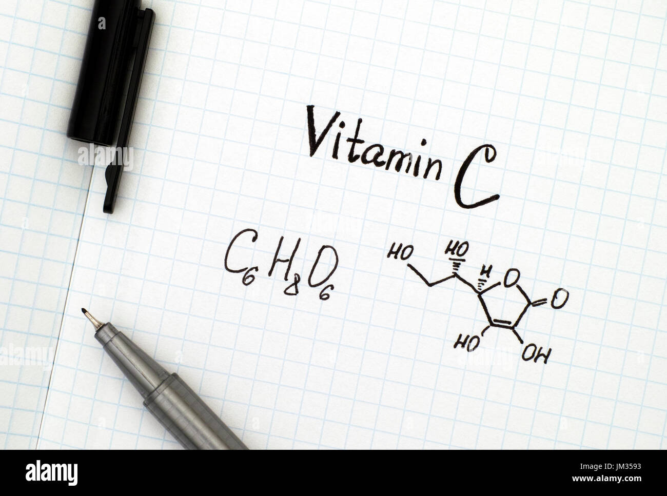 Chemical formula of Vitamin C with black pen. - Stock Image