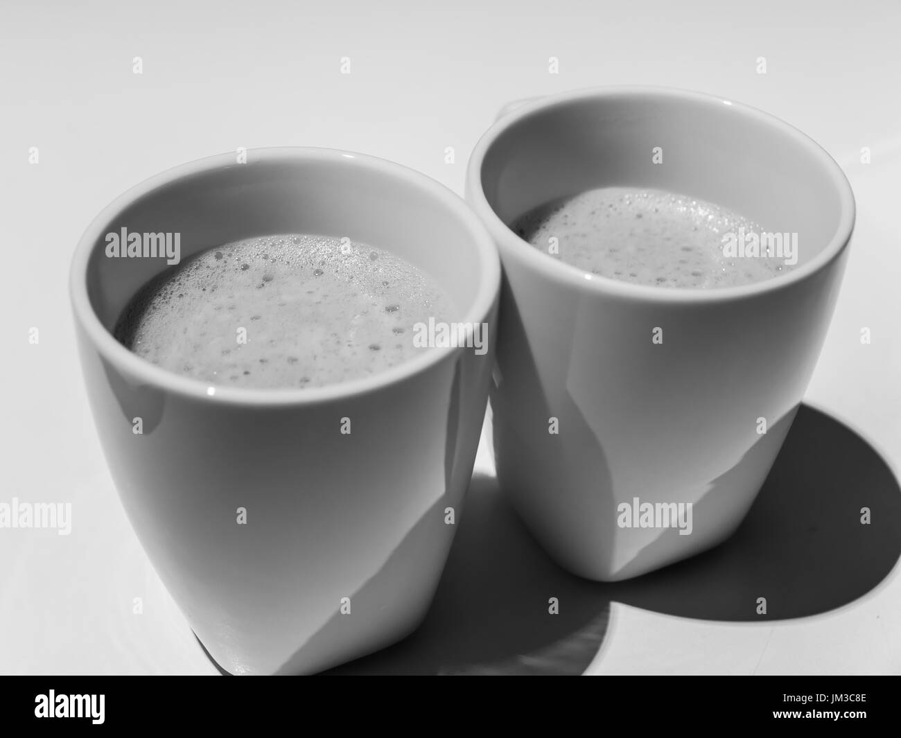 hot coffee in white cups Stock Photo
