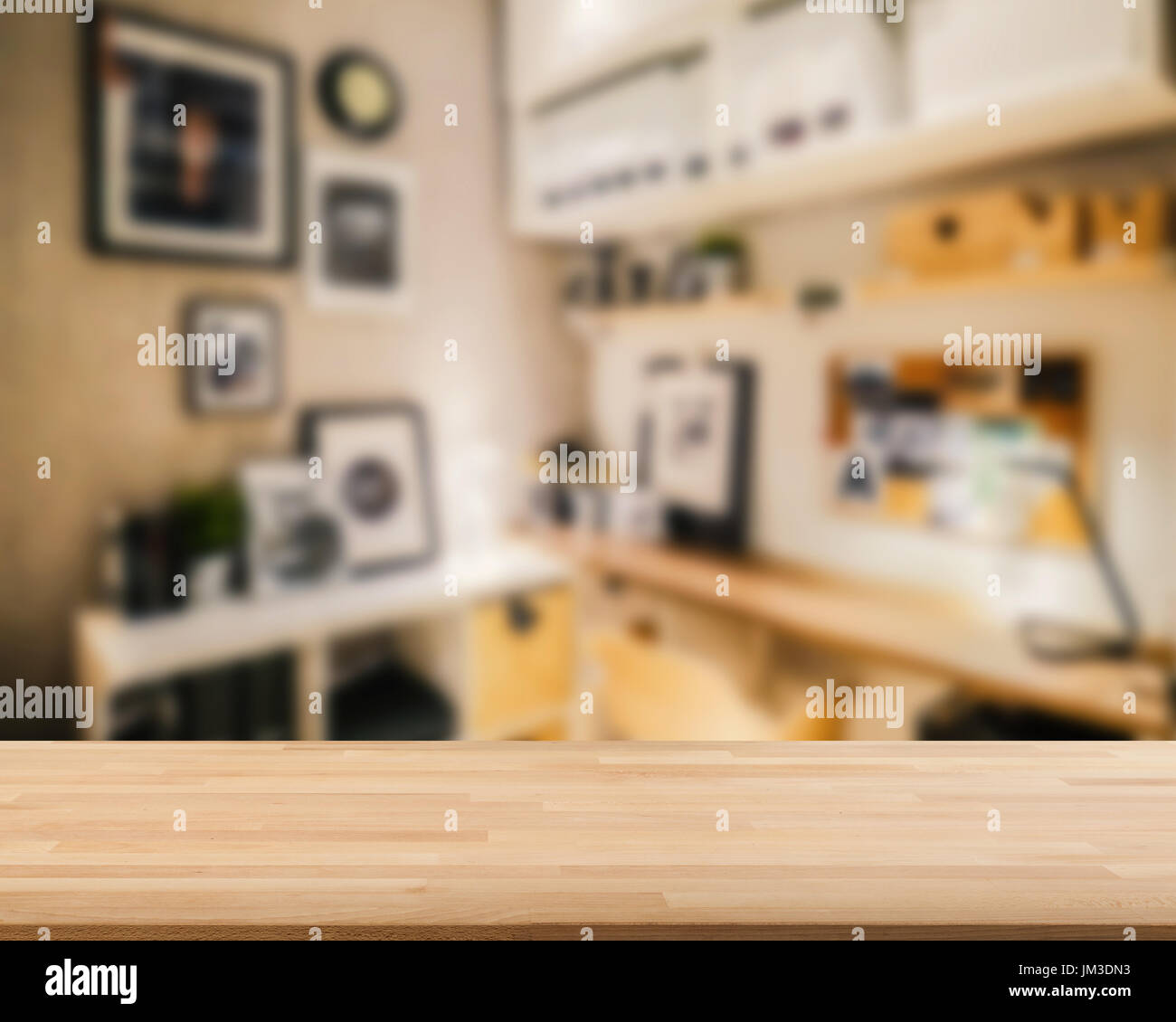 wooden countertop with workspace blurred background - Stock Image