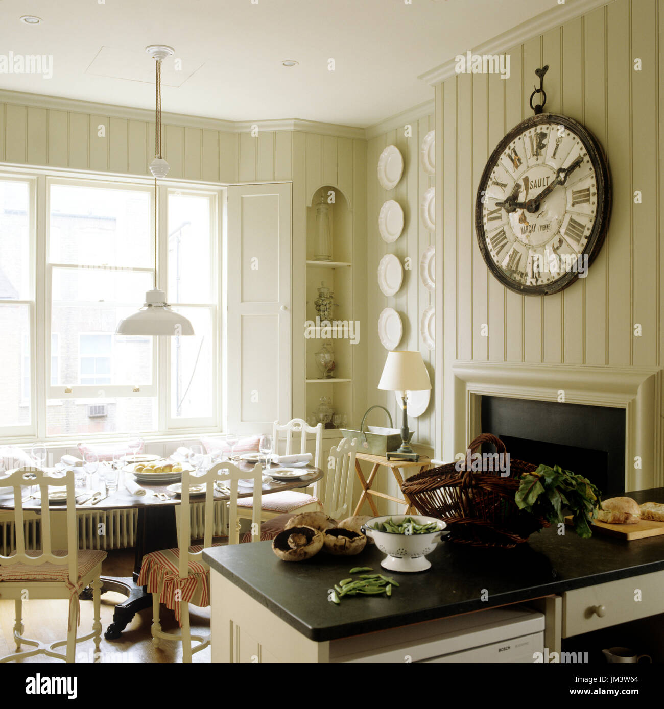 Country style dining room by kitchen - Stock Image