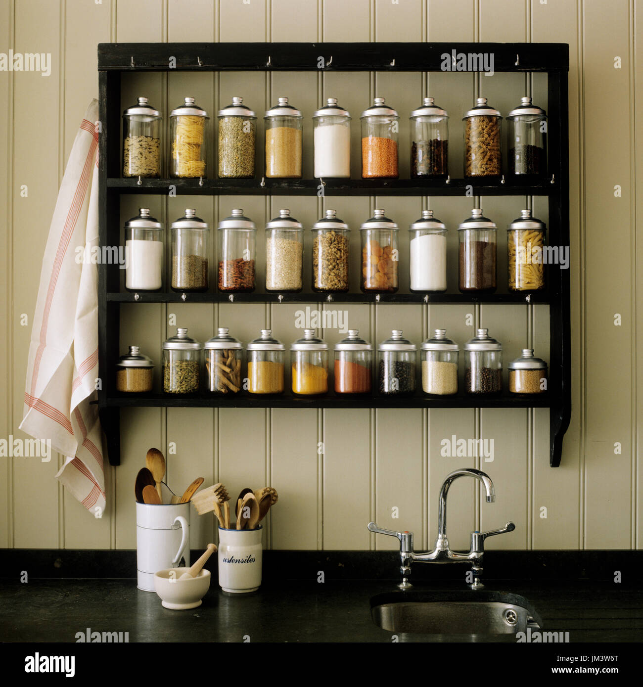 Spice rack above bench stock image