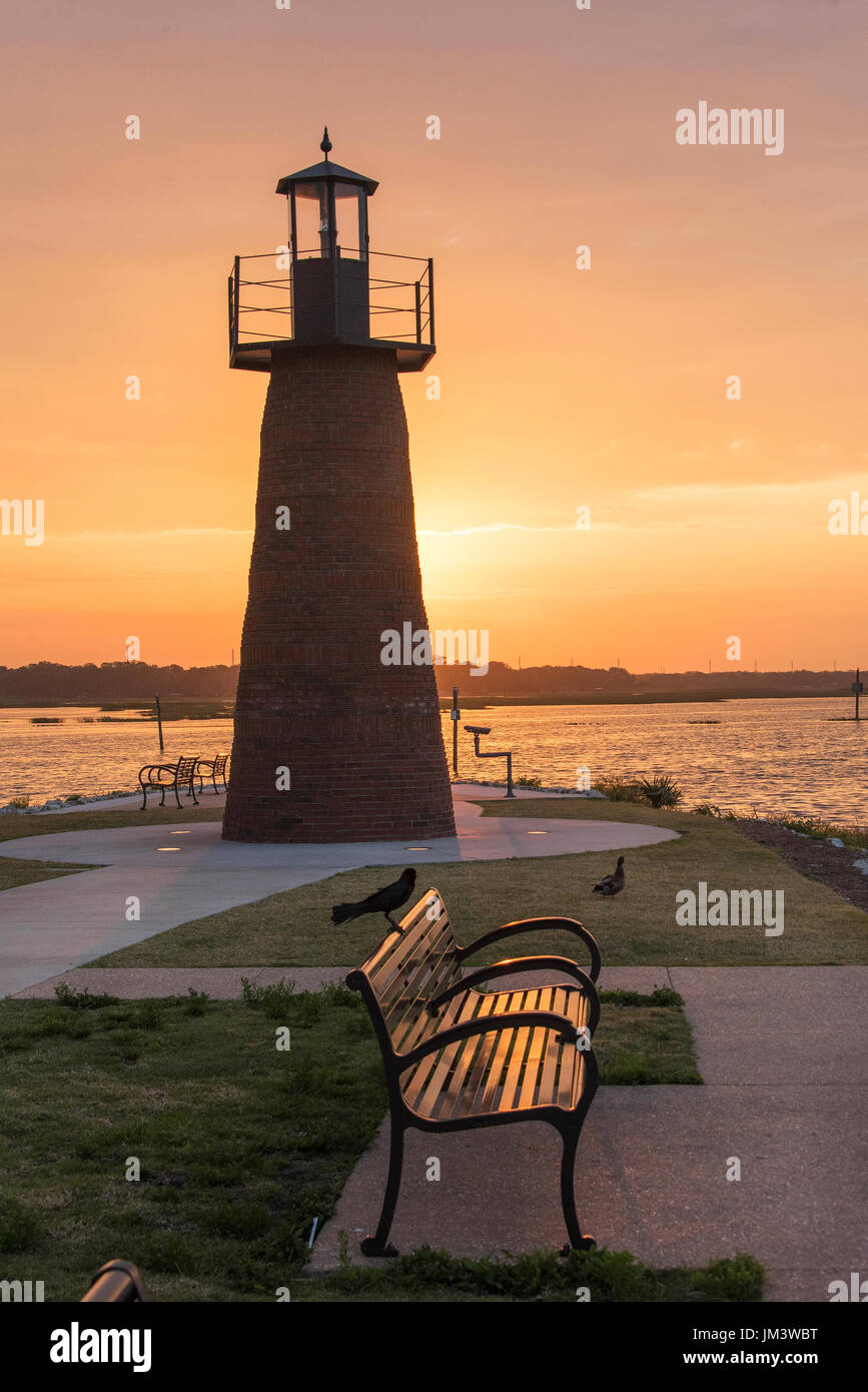 Mini Lighthouse at end of small peninsual leading to Lake Tohopekaliga (Toho) in Kissimme. Part of the Lakefront Park.. - Stock Image