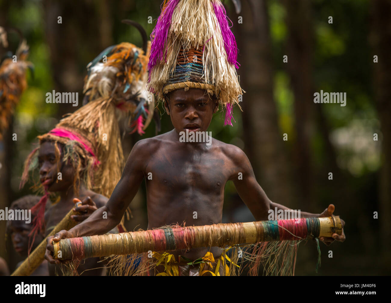 Small Nambas children with Big headdresses dancing during the palm tree dance, Malekula island, Gortiengser, Vanuatu - Stock Image