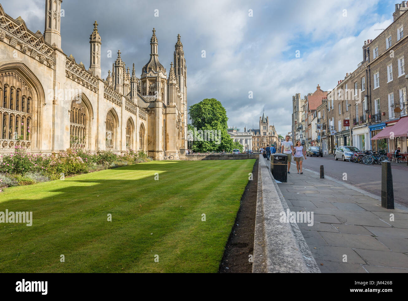 A landscape looking view down King's Parade road in Cambridge city centre with King College on the left, Cambridge, Cambridgeshire, UK - Stock Image