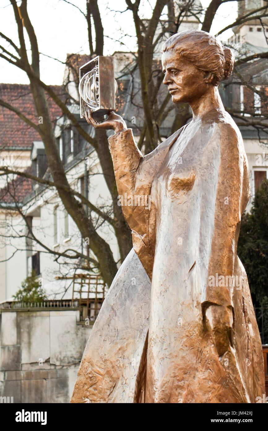 Warsaw, Poland - December 2, 2014: Sculpture of Marie Sklodowska-Curie by polish sculptor Bronislaw Krzysztof. The Nobel prize winning scientist is ho Stock Photo