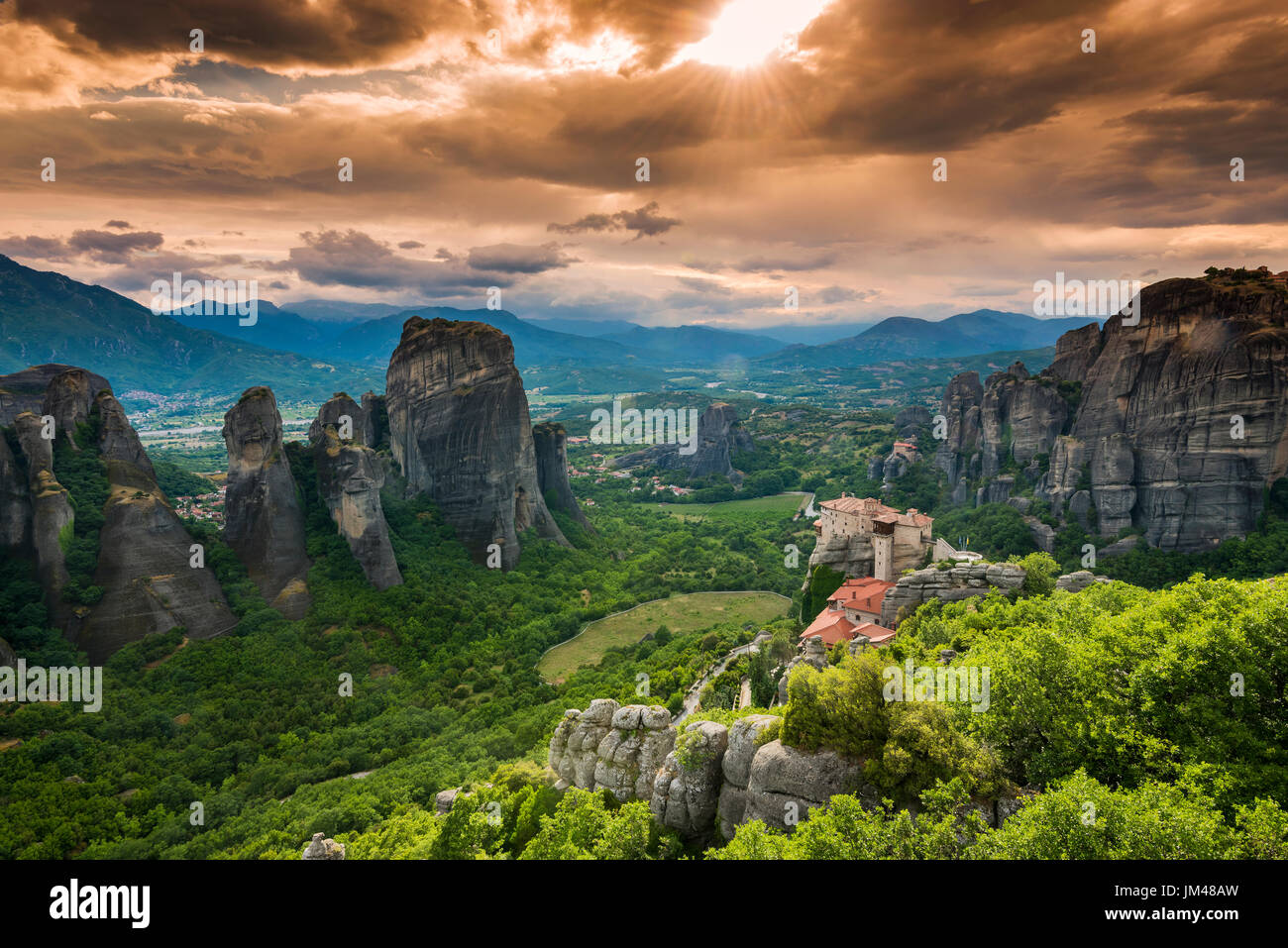 Sunset view over Monastery of Moni Agias Varvaras Roussanou and the spectacular massive rocky pinnacles of Meteora, Thessaly, Greece - Stock Image