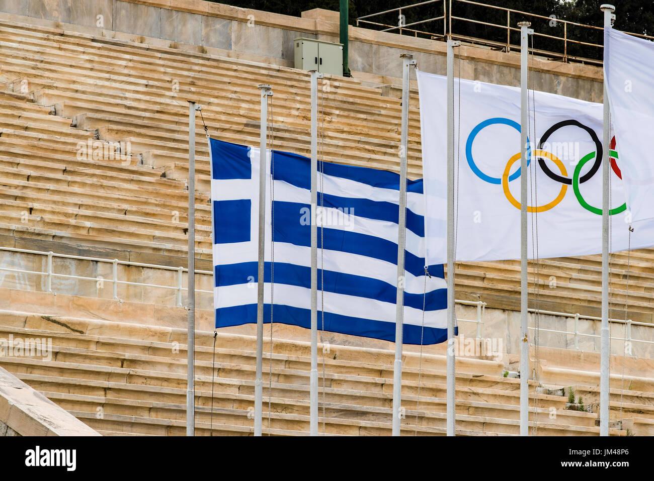Greek flag and Olympic flag weaving at Panathenaic Stadium, Athens, Attica, Greece - Stock Image