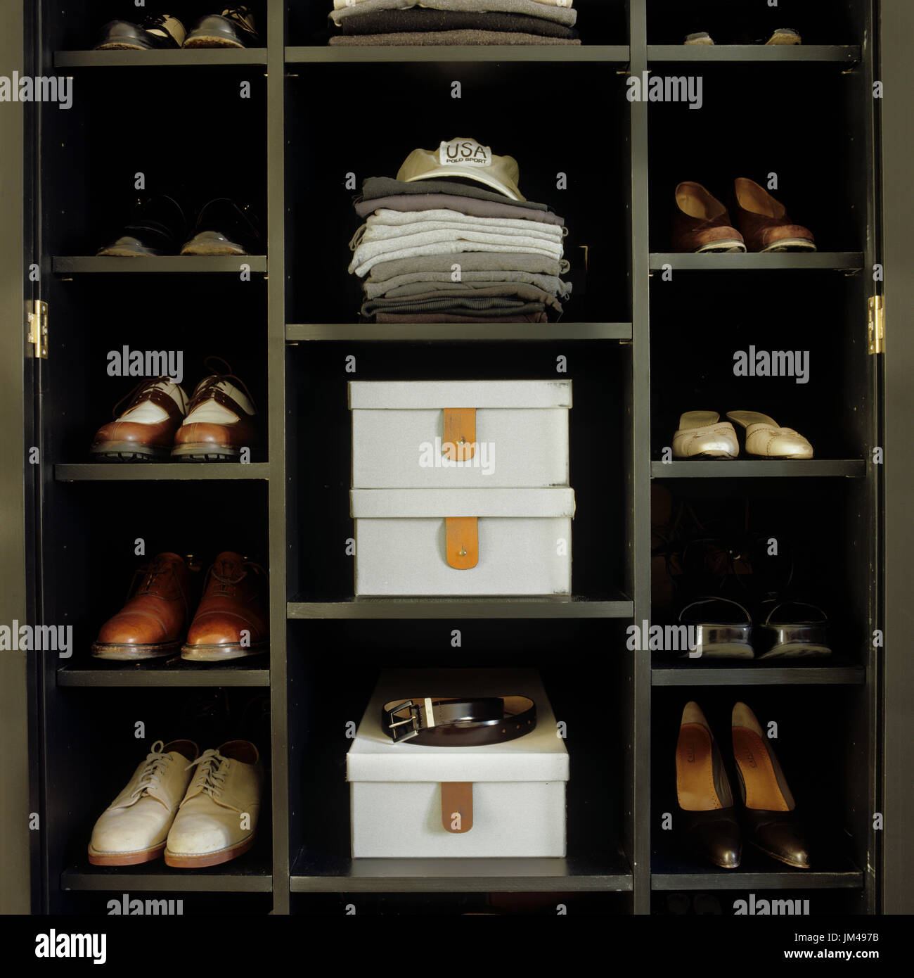 Shoes and clothing in closet - Stock Image