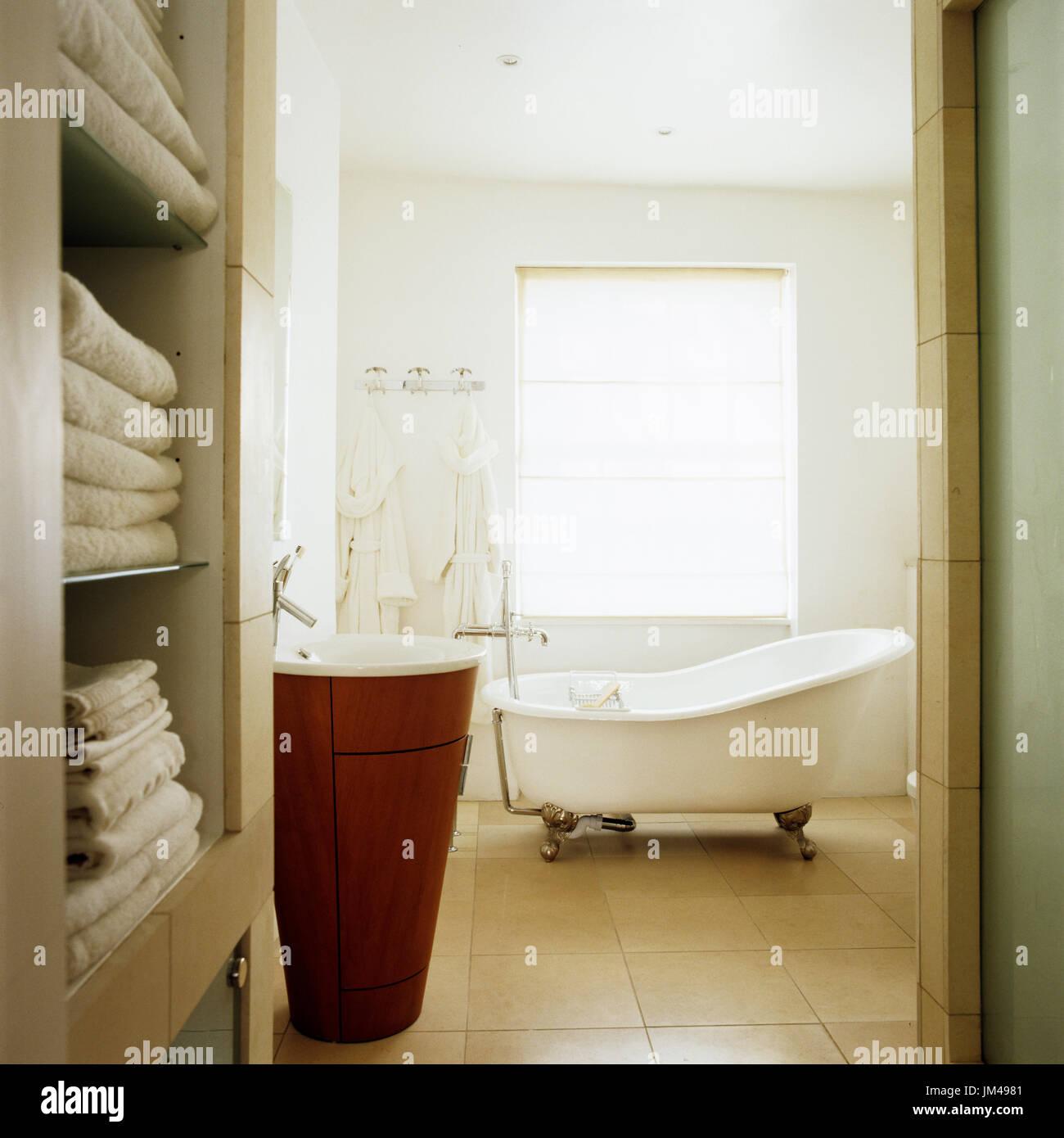 Bathroom with freestanding bathtub - Stock Image