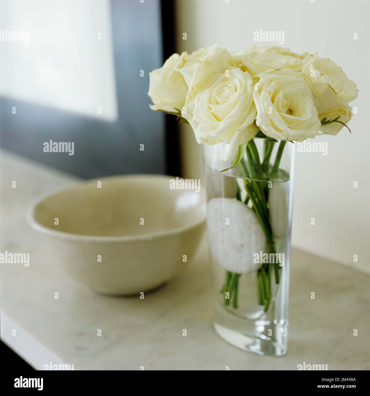 White flowers in vase - Stock Image