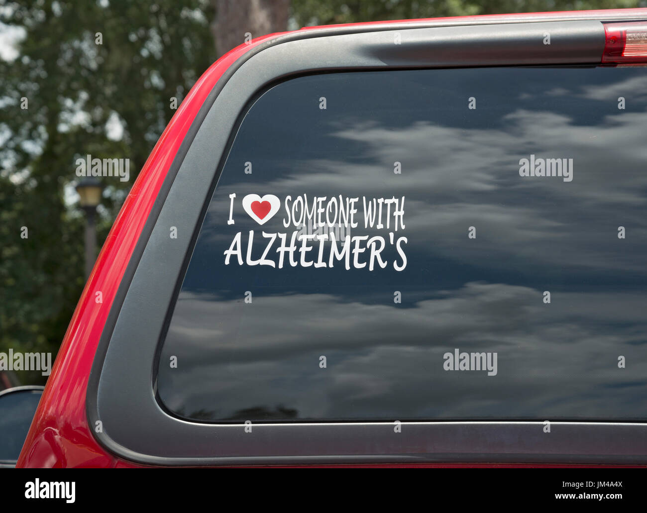 Alzheimers sticker in rear window of pickup truck stock image