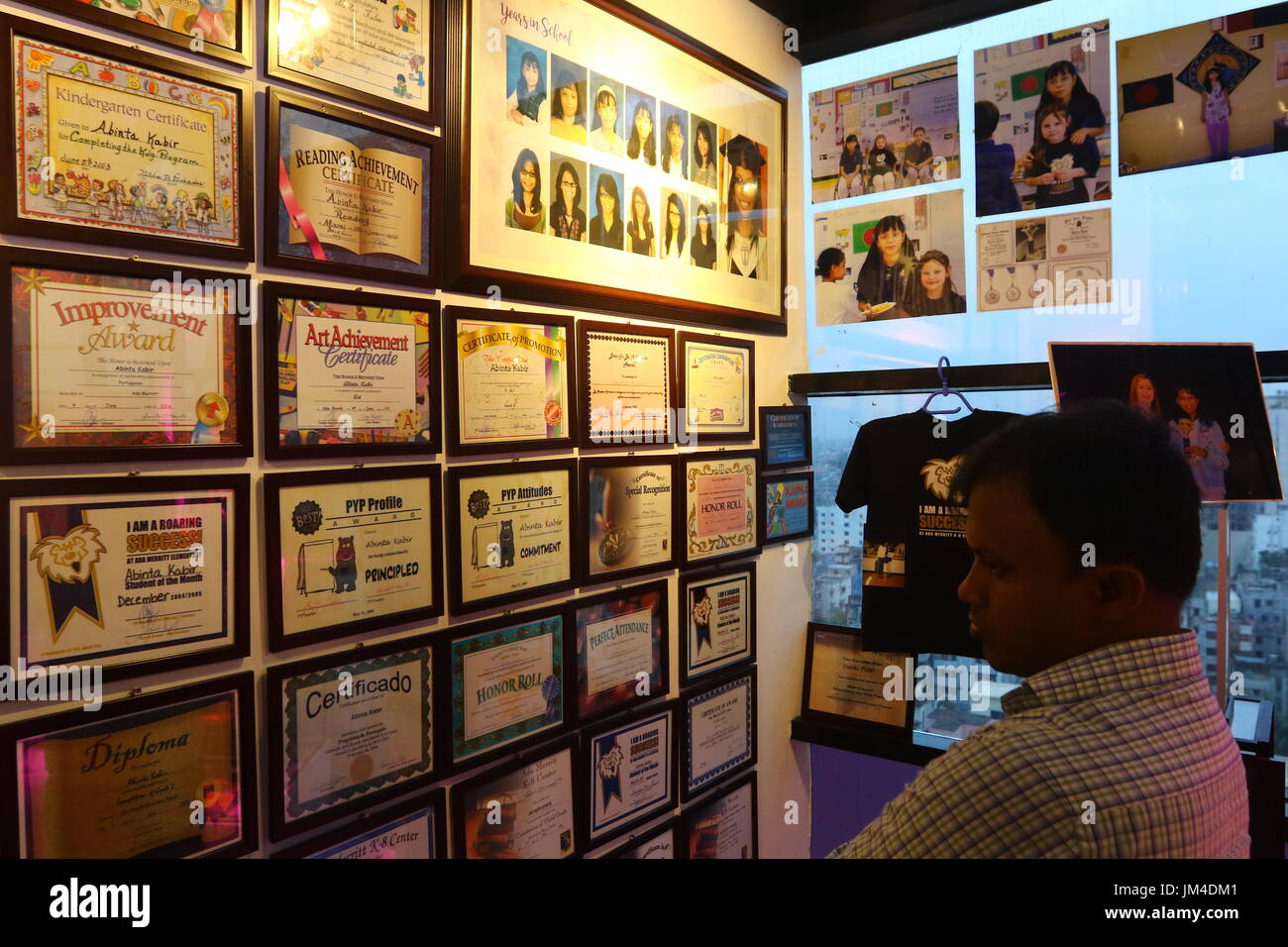 office space memorabilia. visitors look at the memorabilia of abinta kabir on display in a corner office space foundation. was killed during terro m