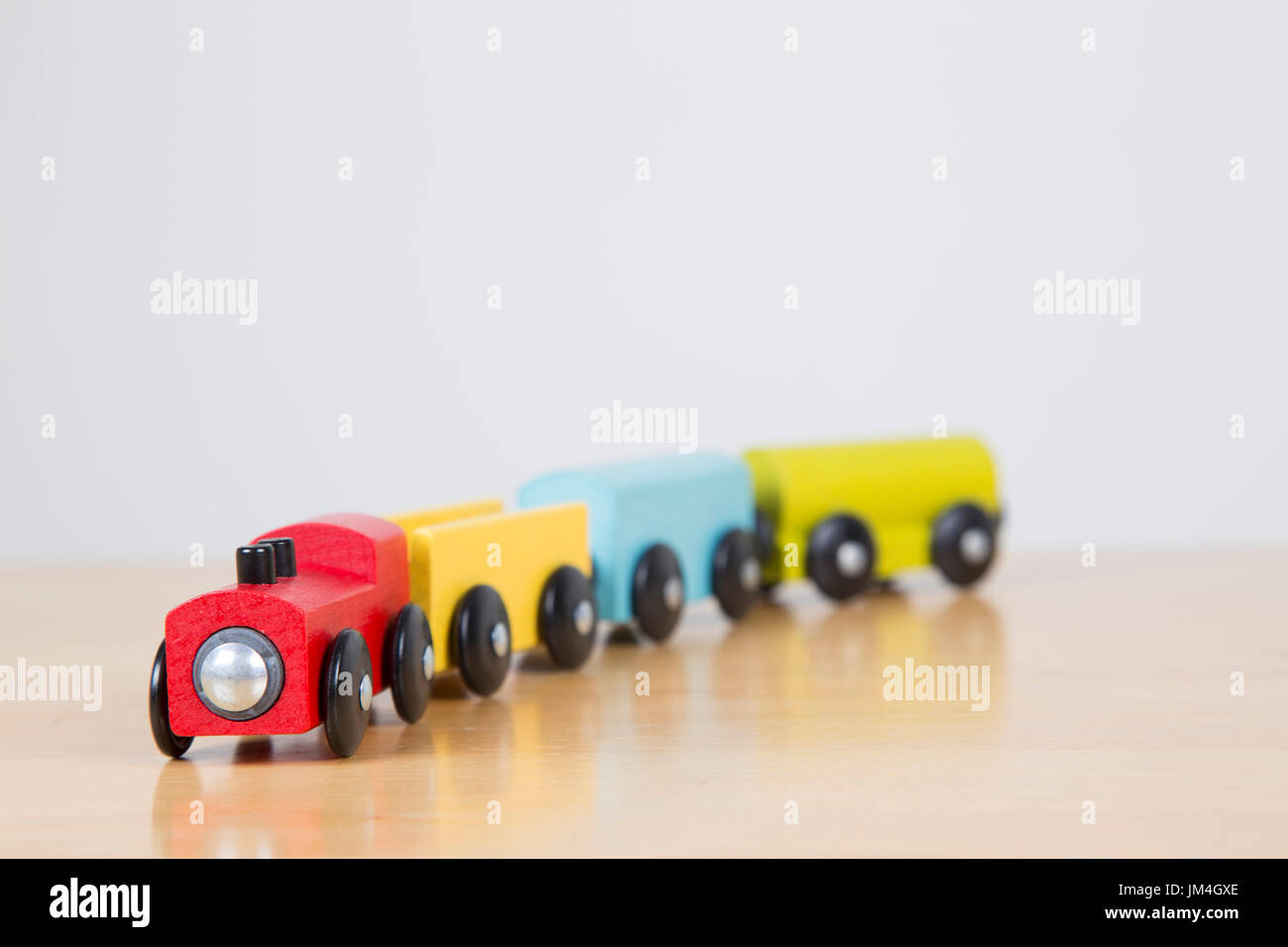 Wooden Train Set On A Wooden Table Top Stock Photo