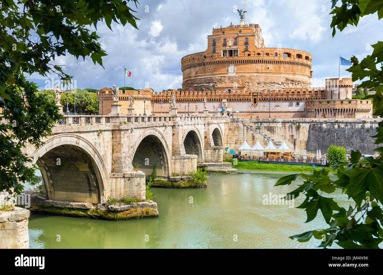 View of Sant Angelo fortress and bridge over Tiber river in Rome. Italy - Stock Image