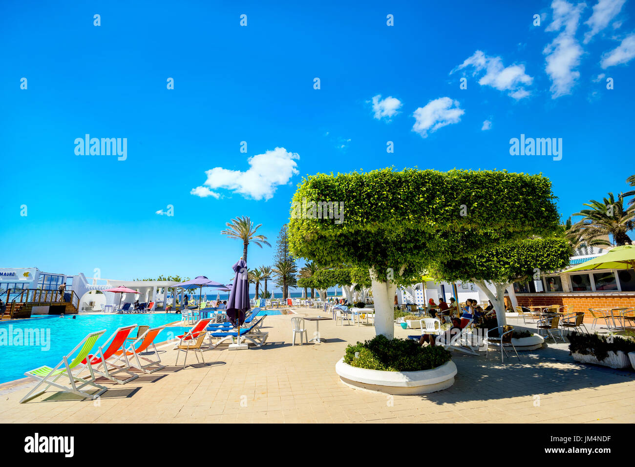 Courtyard with swimming pool of resort hotel on seaside in Nabeul. Tunisia, North Africa - Stock Image