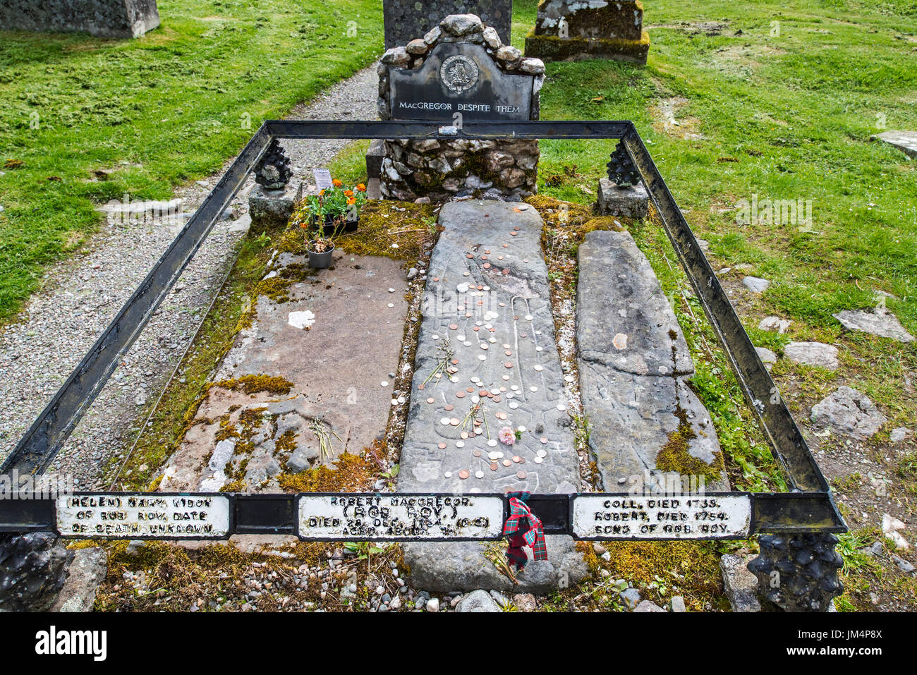 Coins on the graves of Rob Roy MacGregor, his wife Mary and his two sons Coll and Robin at the Balquhidder kirkyard, Stirling, Scotland, UK Stock Photo