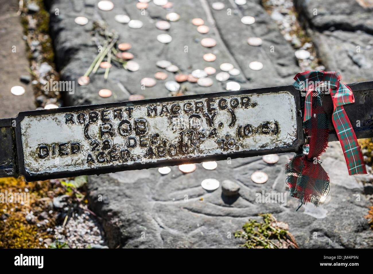Coins on the grave of Rob Roy MacGregor at the Balquhidder kirkyard, Stirling, Scotland, UK Stock Photo