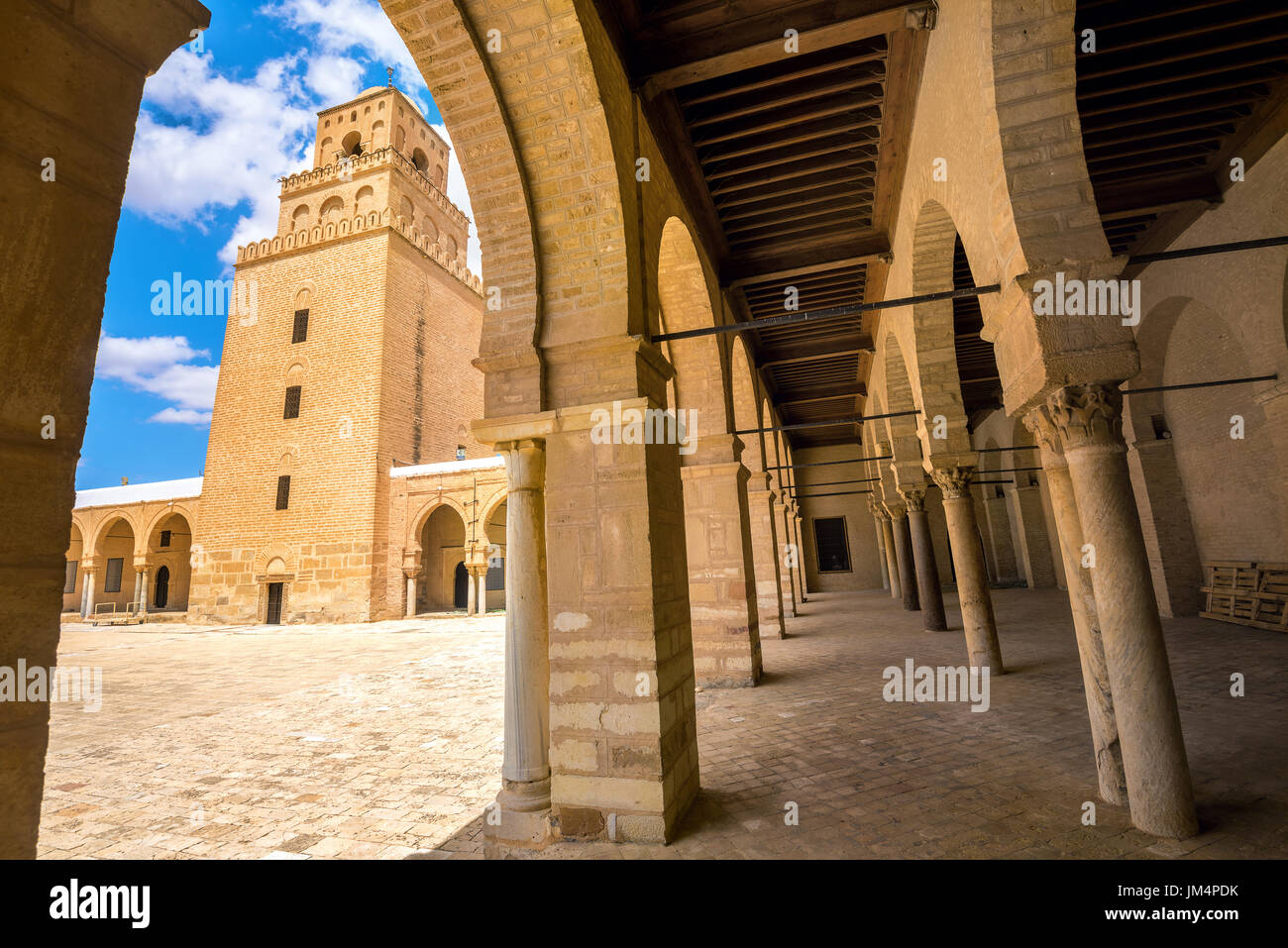 Beautiful view of Great Mosque through arcade of courtyard. Tunisia, North Africa - Stock Image