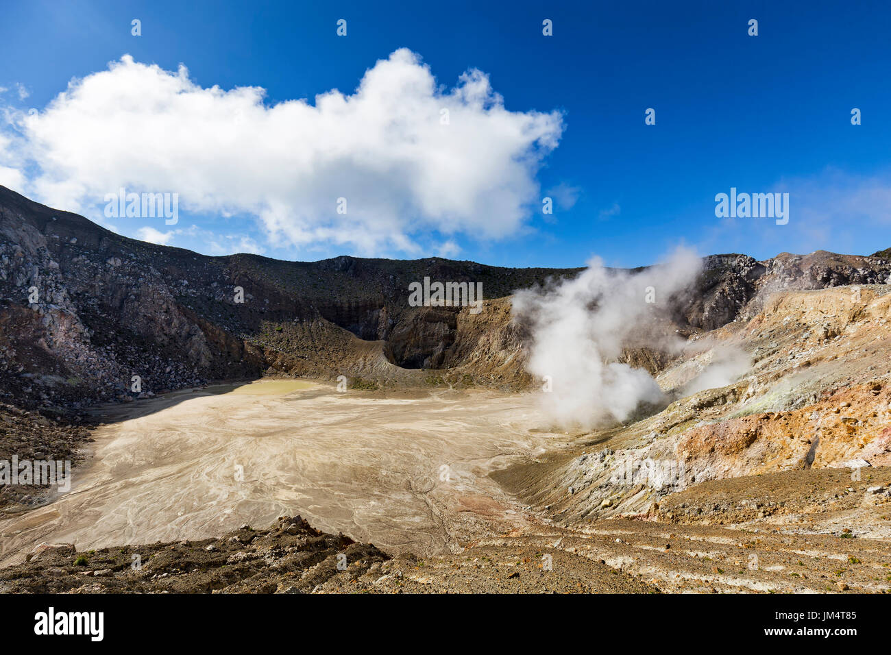 An active sulfur vent spits gasses inside the stratovolcano, Mount Egon in East Nusa Tenggara in Indonesia. - Stock Image