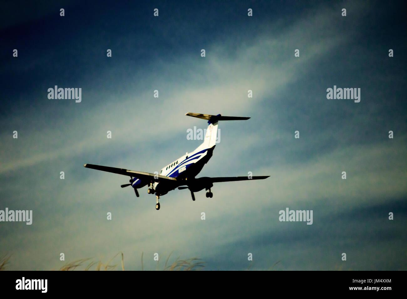 A small prop passenger plane landing. Stock Photo