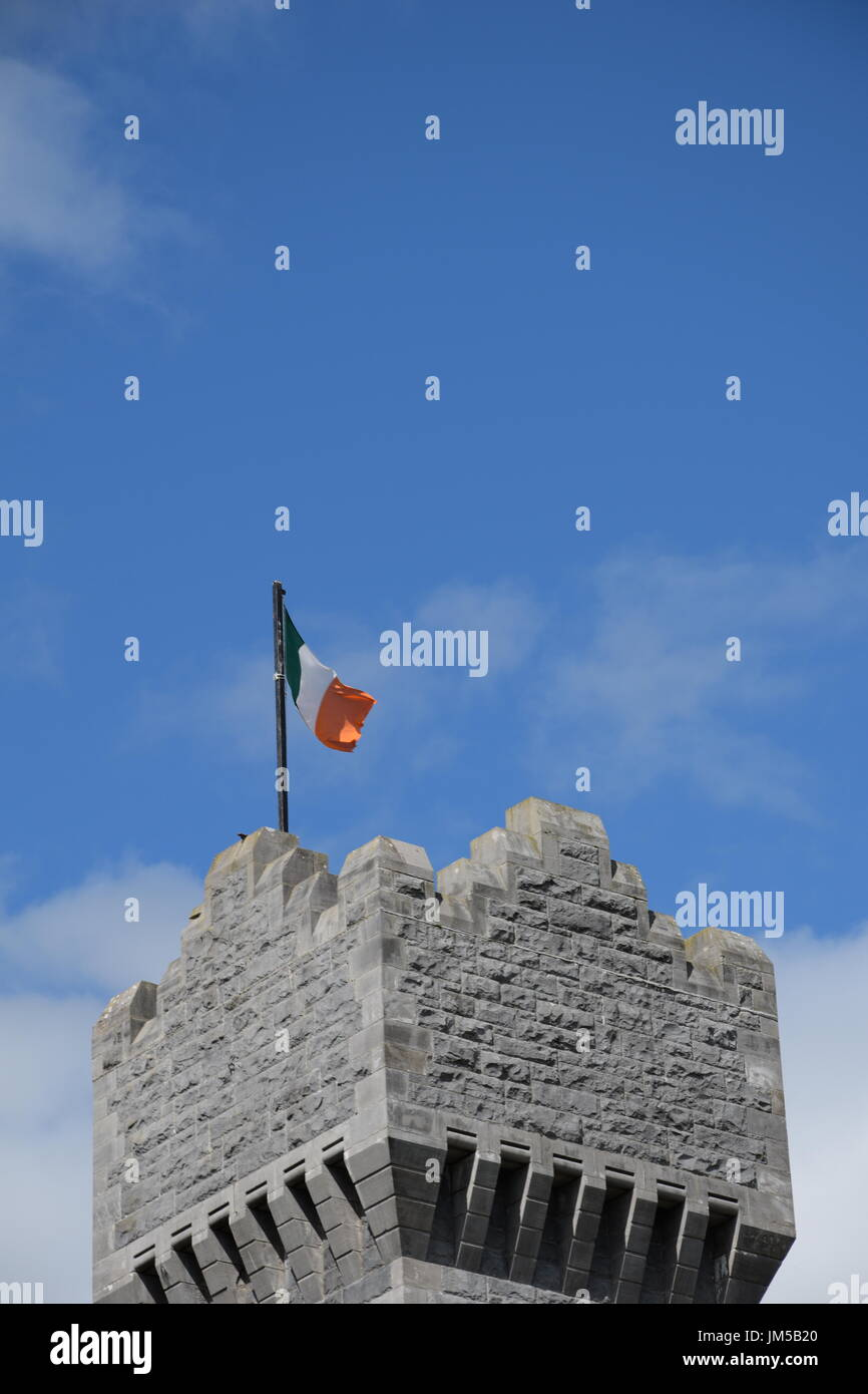 Irish flag flying on flagpole at Ashford Castle tower - Stock Image