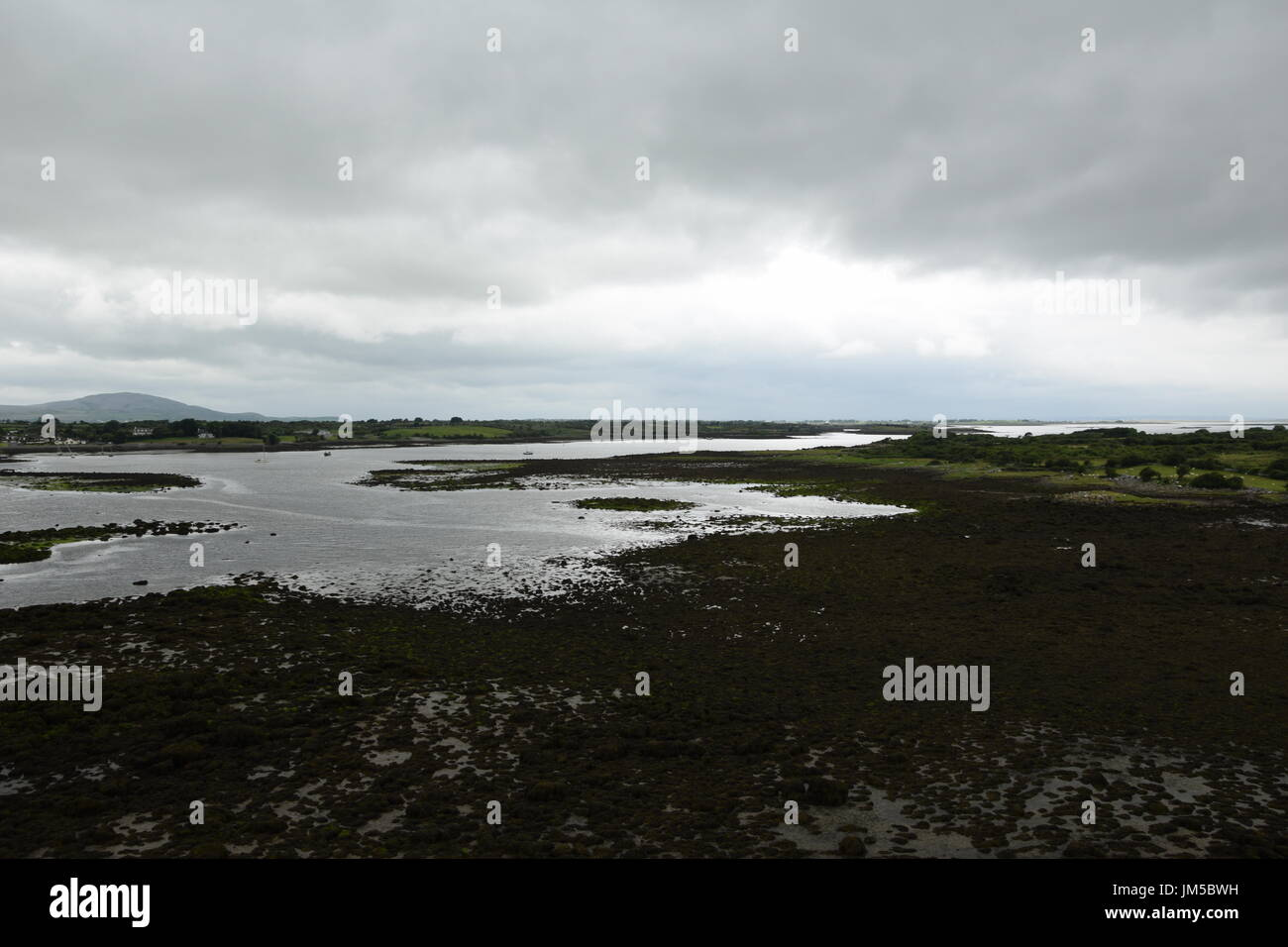 View from the Dunguaire Castle to the bay at low tide and Kinvara City Stock Photo