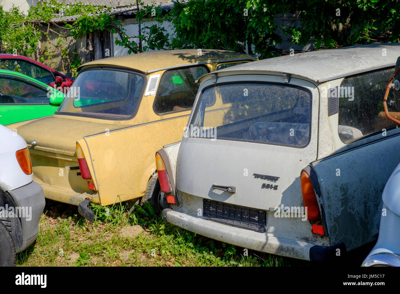 Scrapped trabant 601s cars at the edge of a garage for Garage jm auto audincourt
