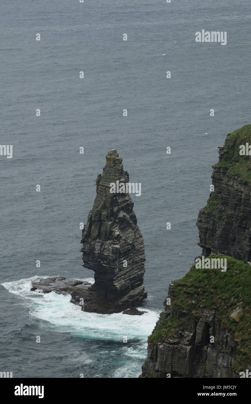 View of the Cliffs of Moher with Branaunmore sea stack in the County Clare, west Ireland Stock Photo